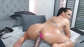 Large-Breasted tattooed cougar fucks mortal physically with a dildo