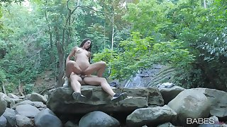 Nude girl rides cock yon the forest be useful to a seductive cam play